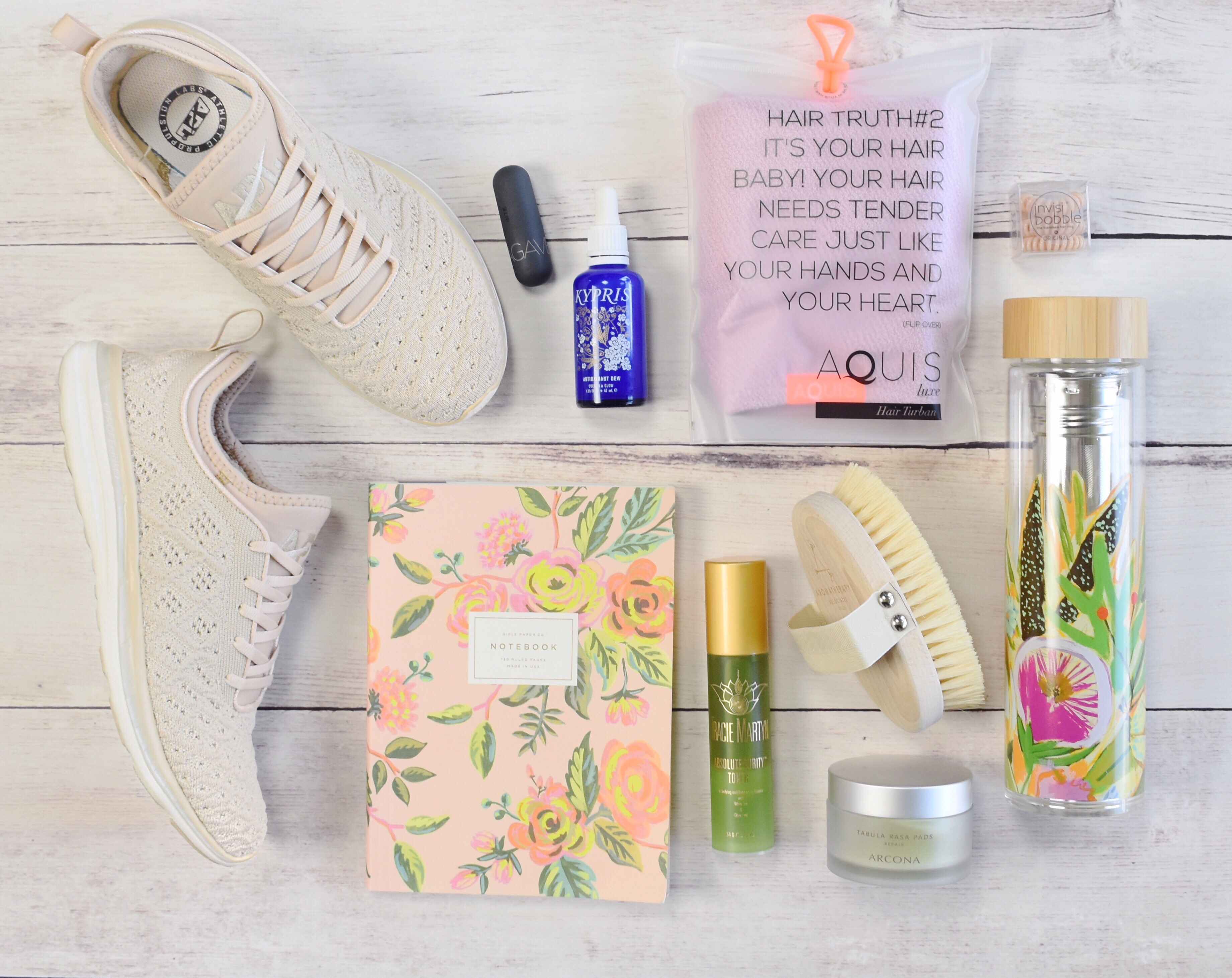 APL Techloom Phantom; rifle paper co notebook; food journal; bite beauty agave balm; Tracie martyn absolute purity toner; body brush; arcona tabula rasa pads; ingrown hairs; aquis hair turban; invisibobble hair ties; kypris antioxidant dew; lulie wallace anthropologie water bottle